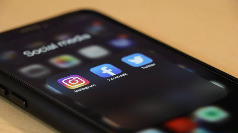 Instagram, Facebook and Twitter logo on a phone screen.