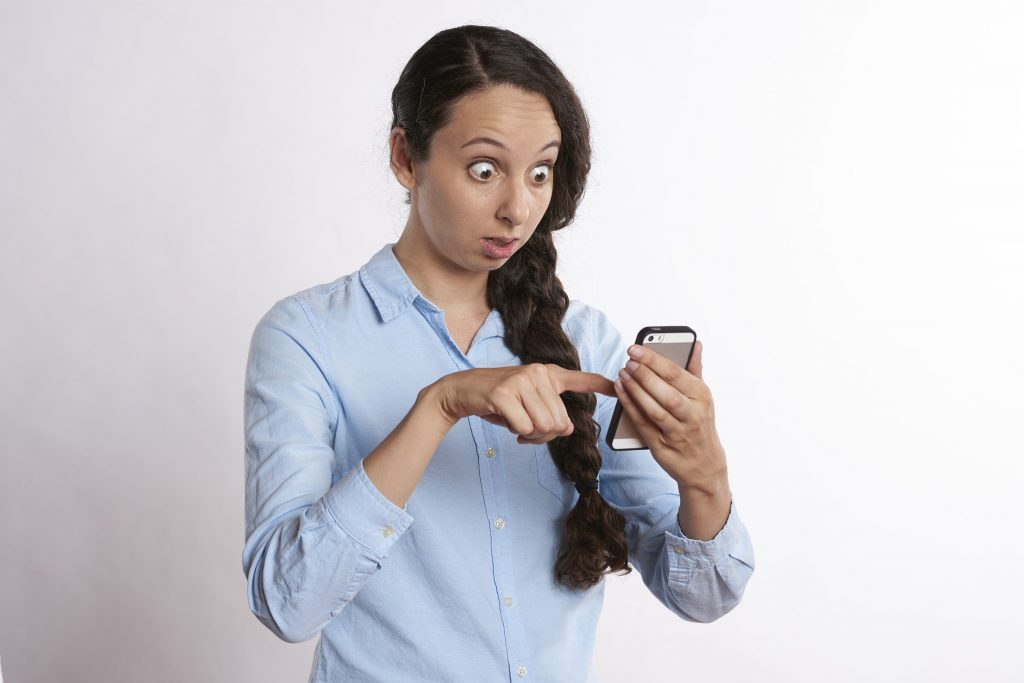 Women looking shock while on the phone