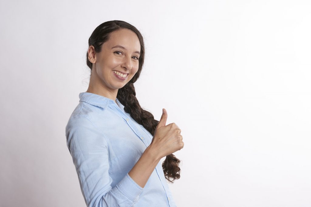 Women with thumbs up